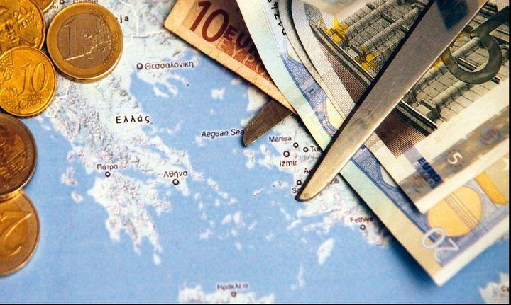 Αυτός είναι ο Γερμανός που κρατά στα χέρια του τον φάκελο του ελληνικού χρέους
