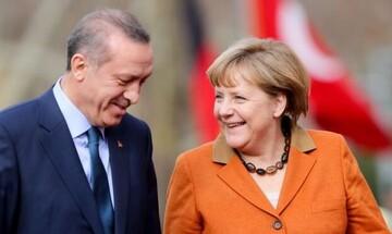 Γερμανικά ΜΜΕ: Η Μέρκελ κάνει τα πάντα... για να βοηθήσει τον Ερντογάν