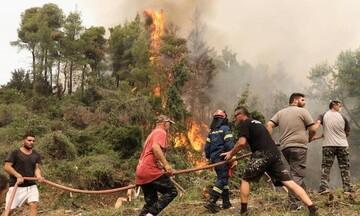Συνεχείς αναζωπυρώσεις σε Γορτυνία και  Βόρεια Εύβοια - Εκκενώσεις οικισμών